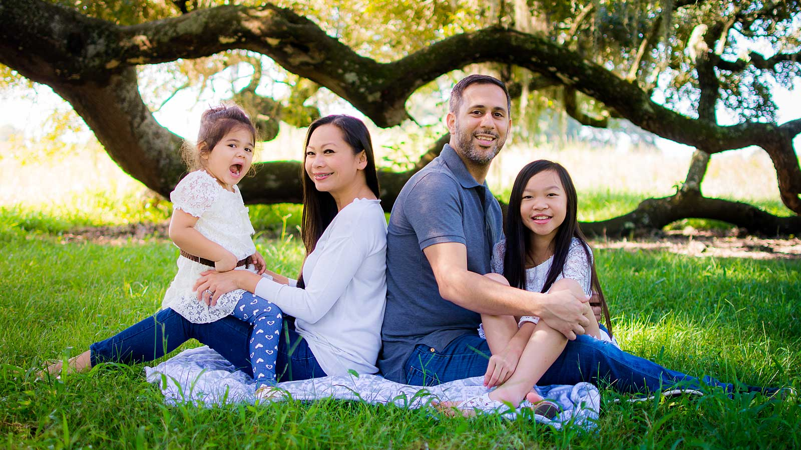 Outdoor family photo session under the oak trees by Needville, Texas family photographer Kristen Richards